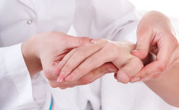 Massage of hands on white. Manicure Royalty Free Stock Photo