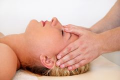 Massage of the head and face in spa center Stock Image