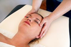 Massage of the head and face in spa center Stock Photo