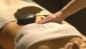 Massage with hot basalt stones stock video footage