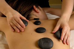 Massage Hot Mineral Stone Back Royalty Free Stock Photos