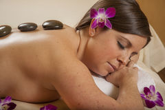 Massage Hot Mineral Stone at Day Spa Stock Photo