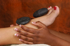 Massage Hot Mineral Stone Feet Royalty Free Stock Photos
