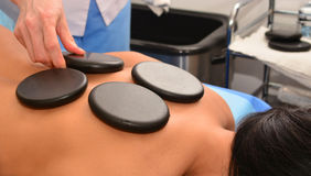 Massage with hot stones Stock Photo