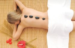 Massage with hot volcanic stones royalty free stock photo