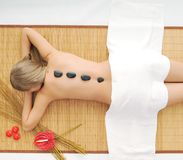 Massage with hot volcanic stones royalty free stock photos