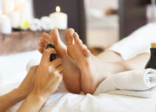 Massage of human feet in spa salon royalty free stock photo