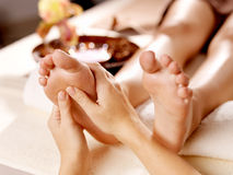 Massage of human foot in spa salon. Soft focus image royalty free stock image
