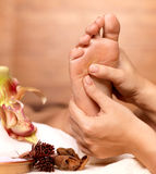 Massage of human foot in spa salon stock photography