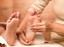 Massage of human foot in spa salon. Soft focus image Stock Photos