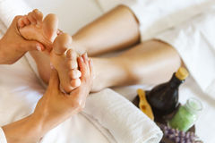 Massage of human foot in spa salon Stock Photos