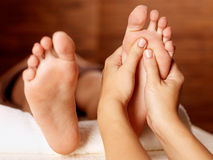 Massage of human foot in spa salon Royalty Free Stock Photography