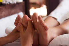 Massage of human foot in spa salon - Soft focus Royalty Free Stock Photos