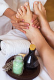 Massage of human foot in spa salon - Soft focus Stock Image