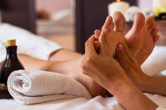 Massage of human foot in spa salon - Soft focus Stock Photo