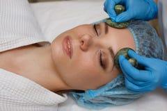 Massage with jade stones. Gua sha Royalty Free Stock Image