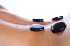 Massage - lava stone Stock Photos