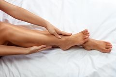 Massage for legs and ankles Royalty Free Stock Images