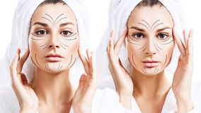 Massage lines on beautiful face of young woman in bathrobe. Spa concept royalty free stock photography