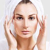 Massage lines on beautiful woman`s face. royalty free stock images