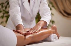 Massage of the lower limb Royalty Free Stock Image