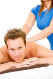 Massage: Man Gets Back Massage. Series of a young couple getting massages by therapists.  Together, as well as separate.  Bright and clean Royalty Free Stock Photo