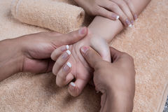 Massage after manicure stock photography