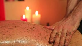 Massage with mixture of herbs for a woman stock video footage