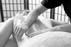 Massage monochrome. Young lady at a natural hot oil massage as a monochrome image Stock Photography