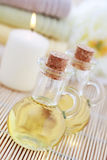Massage oil. Bottles of massage oil with towels - beauty treatment stock image