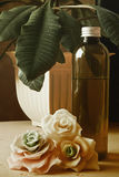 Massage oil. And porcelain rose royalty free stock images