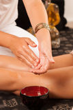 Massage oil. Massage therapist moistening her hands in oil royalty free stock images