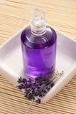 Massage oil. Lavender massage oil - beauty treatment stock photo