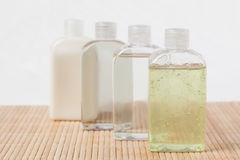 Massage oil bottles. Against a white background stock image