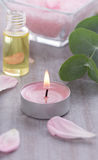 Massage oil with candle - spa decoration Royalty Free Stock Image