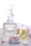 Massage oil with candle - spa decoration Stock Photos