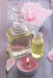 Massage oil with candle - spa decoration Royalty Free Stock Photography