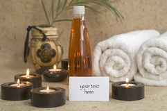 Massage oil with candles and towels Royalty Free Stock Image