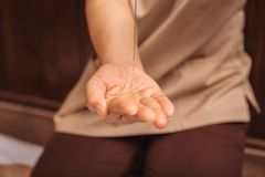 Close up of a female hand with oil. Massage oil. Close up of a female hand with massage oil being put on it stock images