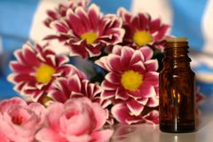 Massage oil and flowers Stock Photo