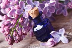 Massage oil from fragrant lilac flowers macro Stock Photo