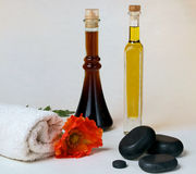 Massage oil with hot stone Stock Images