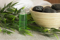 Massage oil and hot stones Royalty Free Stock Images