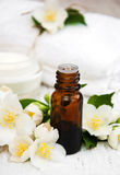 Massage oil. With jasmine flowers on a wooden background royalty free stock image