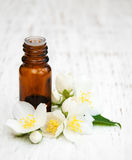 Massage oil. With jasmine flowers on a wooden background stock photography
