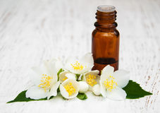 Massage oil. With jasmine flowers on a wooden background royalty free stock images