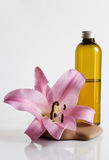Massage oil and lily Stock Photo