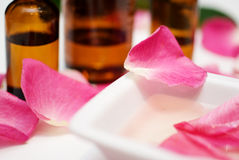 Massage oil from rose petals. Close up royalty free stock photos