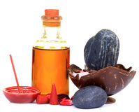 Massage oil and stones. Over white background royalty free stock photo