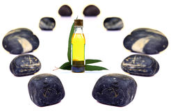 Massage oil and stones Stock Images